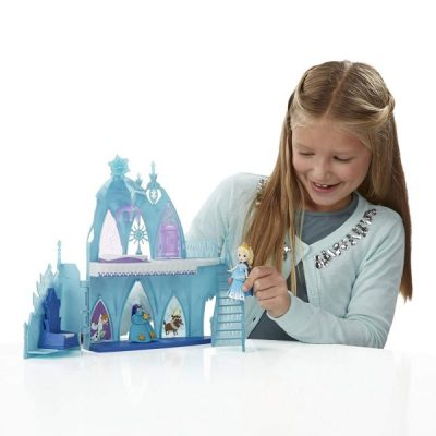 """Disney Frozen Little Kingdom Elsa's Frozen Castle All the little fans of Elsa and her friends can now take their beloved heroes everywhere! This little castle can become their personal kingdom where they can spend whole hours playing and training their imagination. Disney Frozen Little Kingdom Elsa's Frozen Castle - everyone willing to gift their little ones something to play with during the rainy days should check this one out right now! How Much Is It? Elsa's Frozen Castle is a pretty, aesthetic toy that costs around 16$. The set contains a little doll of Elsa, the castle and a lot of other parts. These include two bodices, two peplums, two skirts for Elsa, two different capes, and four snap-ins. For this relatively small price, you get a lot of pieces for your child to combine the way they want to! Who Would Buy It? The toy is designed to resemble the character from the famous animated movie """"Frozen"""". It is an ideal gift for all the little girls who love Elsa and would like to play with her every day. The toy is made to be safe for children of four years of age or more. Things We Like About It The toy is a pretty and colorful construction. It's not ugly at all, even if Elsa's miniature doesn't resemble the Disney's cartoon style. It's small and easy to carry around, so whenever you go on holiday, you can pack it for your child without worrying about the space. It's great that Elsa's look can be modified, seeing as a lot of dolls of this kind limit these possibilities. Things We Did Not Like About It Elsa's Frozen Castle is a pretty piece but unfortunately that's all about it. There is not much to do with the toy and no real ways to interact with it. The child's play will come down to changing the skirts and """"walking"""" the doll up and down the stairs. The pieces are also rather small so if your girl tends to lose her toys, it's likely she will soon have issues to find these parts. Is It Worth The Money? For the number of elements and possibilities it gives, we coul"""
